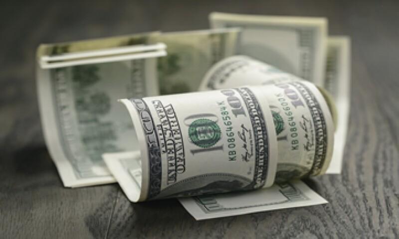 A la compra, el billete verde se ubica en 15.86 pesos. (Foto: iStock by Gettty Images)