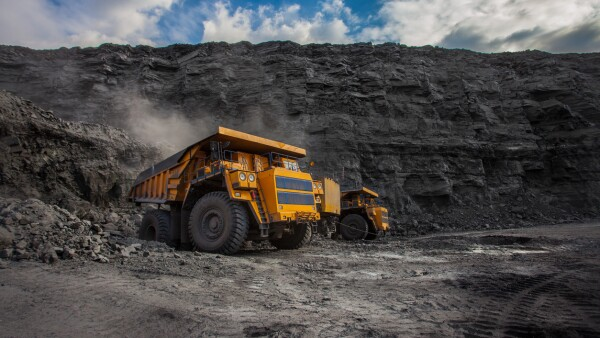 mining dump trucks loaded in a coal mine