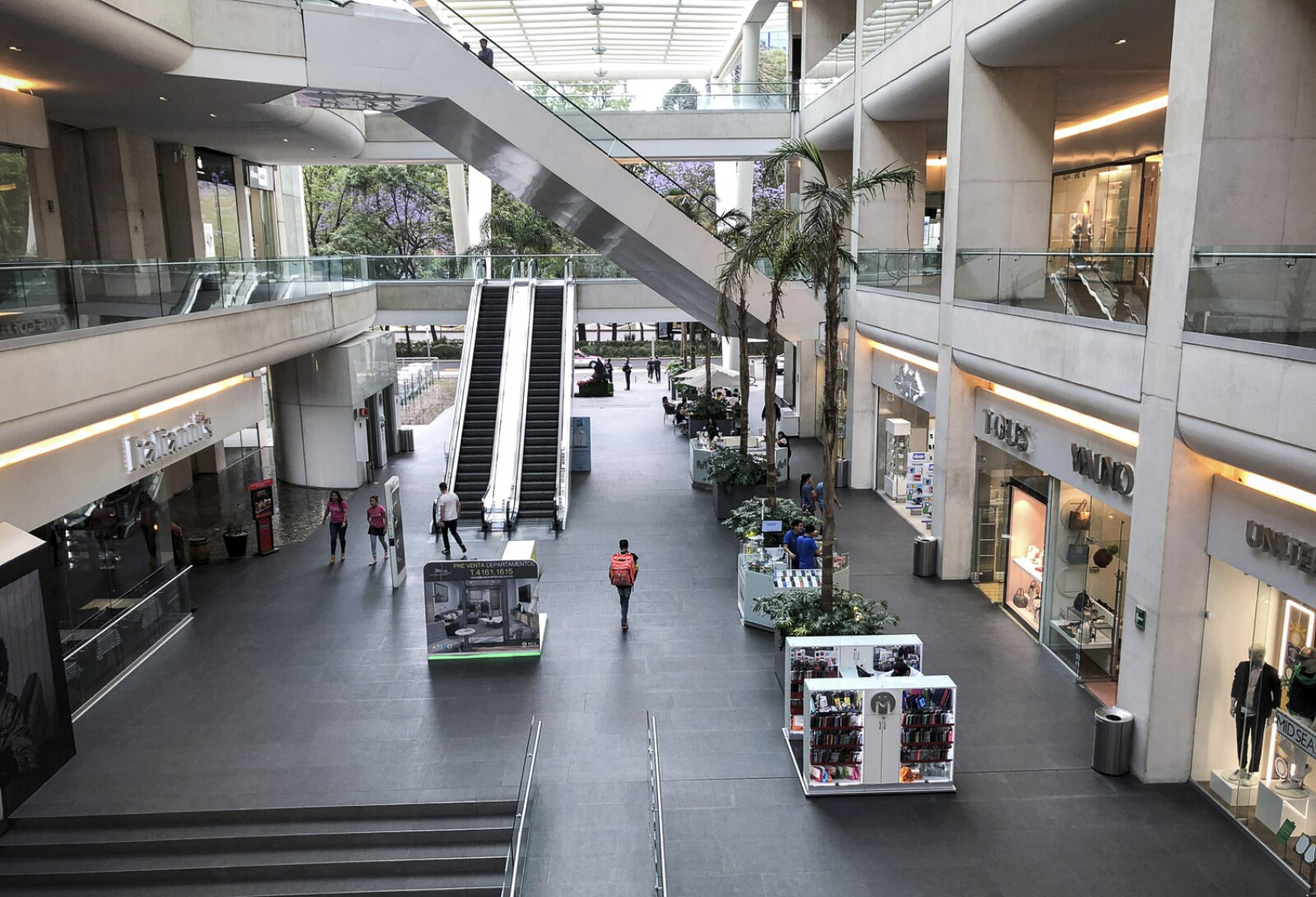 A handful of people walk inside a shop[ing mall as the coronavirus disease (COVID-19) outbreak continues in Mexico City