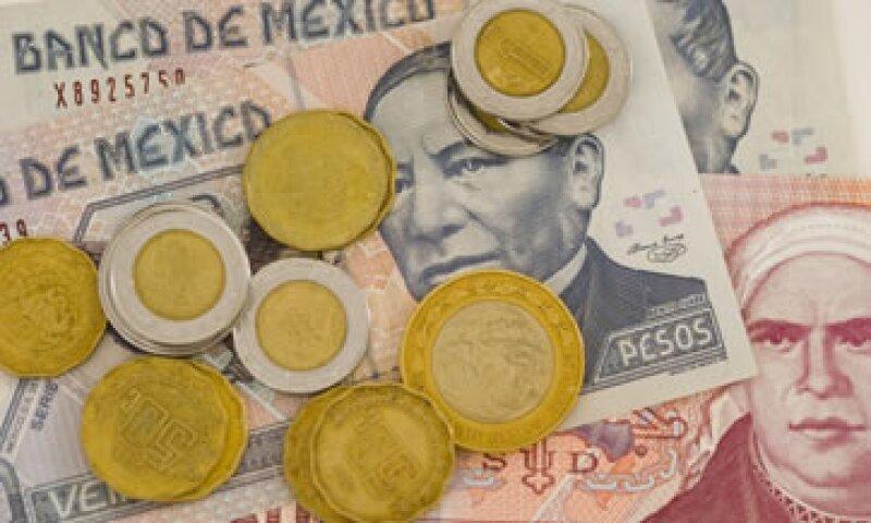 Sindicatos y empresas aún no han llegado a un acuerdo sobre los salarios mínimos en 2013. (Foto: Getty Images)