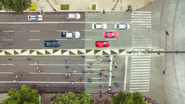 Top view of cars and bikes in avenue