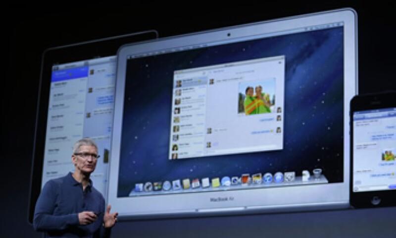 La empresa comandada por Tim Cook dijo que vendió 27 millones de iPhones. (Foto: AP)