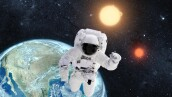 Astronaut in outer space over the planet earth. This image is a collage of different images furnished by NASA