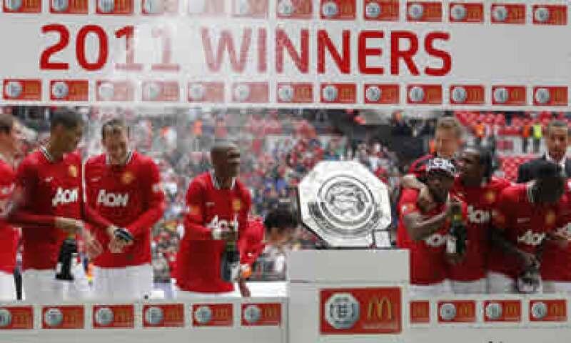 El éxito en el campo de juego del Manchester United se ha traducido en grandes sumas de ingresos comerciales. (Foto: AP)