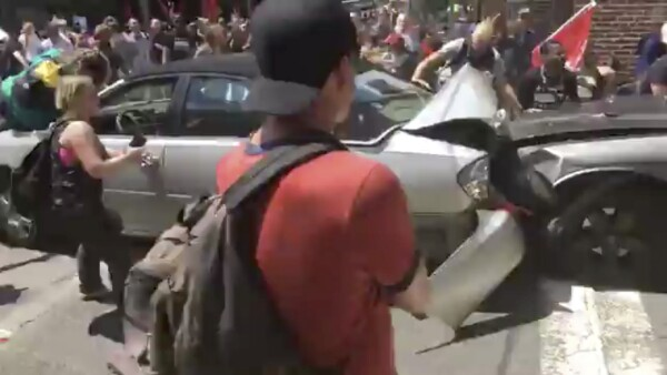 A vehicle plows into the crowd gathered on a street in Charlottesville
