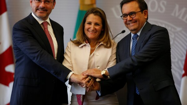 Mexico's Foreign Minister Luis Videgaray, Canada's Foreign Minister Chrystia Freeland and Mexico's Economy Minister Ildefonso Guajardo pose for a picture after delivering a joint message in Mexico City