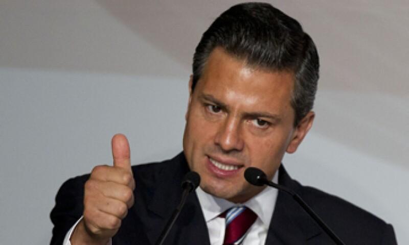 Peña Nieto se pronunció también por alcanzar un mayor crecimiento económico y más recursos a Pemex, sin privatizar. (Foto: AP)