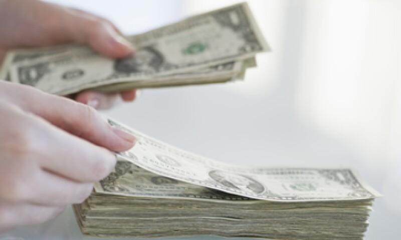El tipo de cambio es de 13.2522 pesos para solventar obligaciones denominadas en moneda extranjera. (Foto: Getty Images)