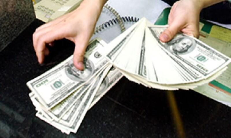 El tipo de cambio  podría ubicarse en un rango de 12.87 y 12.96 pesos por dólar, según Banco Base.  (Foto: Getty Images)