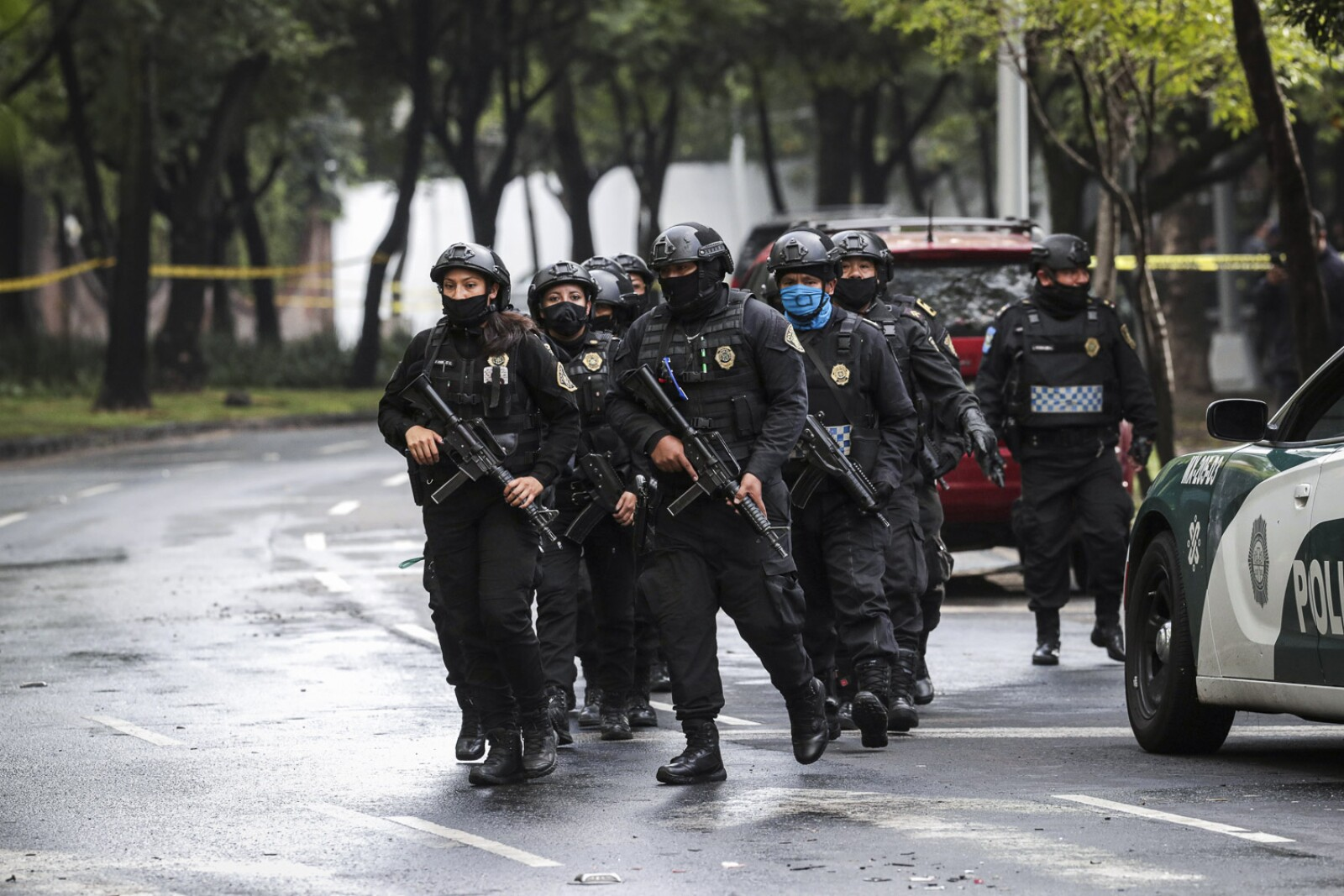 Police officers arrive at the area where a shooting took place in Mexico City