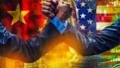 businessman competing in arm wrestling on USA and china flag background