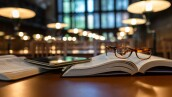 Digital Tablet and Eyeglasses On Books in Public Library