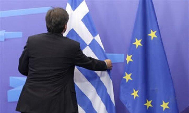 Los acreedores privados de Grecia asumirán una pérdida del 21% de sus bonos. (Foto: AP)