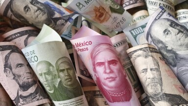 american dollar banknotes and mexican bills of different denominations