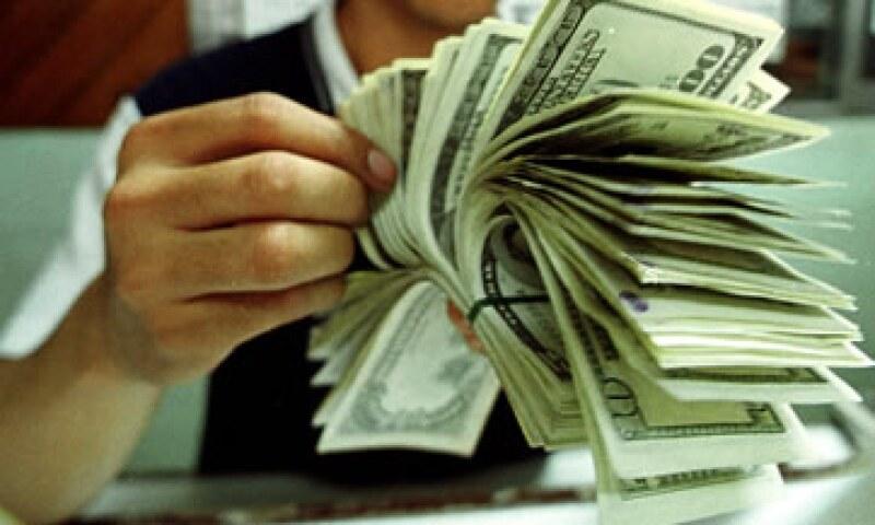 Expertos estiman que el tipo de cambio oscile entre 12.72 y 12.81 pesos. (Foto: Getty Images)