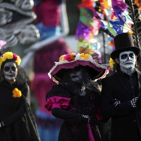 People take part in a Catrina parade ahead of Day of the Dead in Monterrey