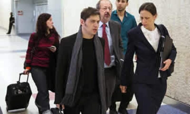 El ministro de Economía argentino, Axel Kicillof –al frente- trató de negociar un acuerdo. (Foto: Reuters)