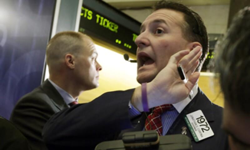 Las pérdidas en Wall Street también daban a los inversores una razón para tomar las ganancias del reciente repunte. (Foto: AP)
