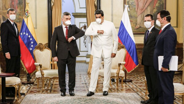 Venezuela's President Nicolas Maduro and Russia's ambassador in Venezuela Sergey Melik-Bagdasarov, touch their elbows while wearing masks due to coronavirus disease while (COVID-19) outbreak at Miraflores Palace in Caracas