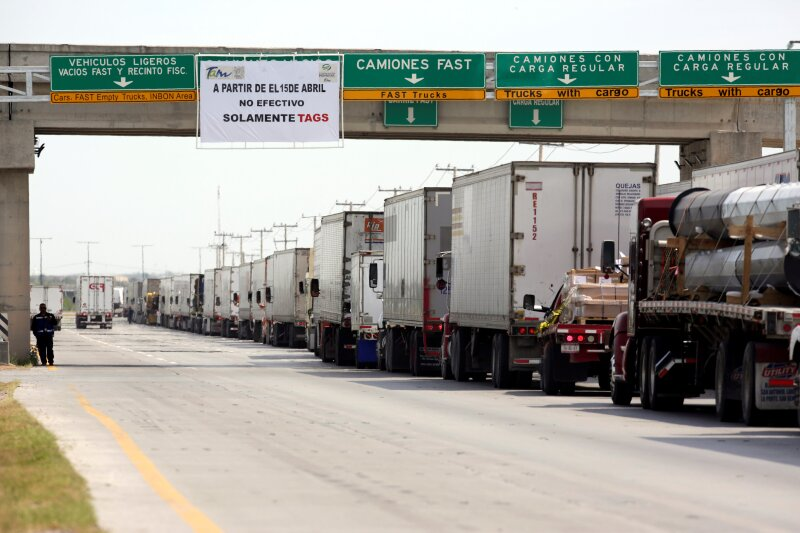 Trucks wait in a long queue for border customs control to cross into U.S. at the World Trade Bridge in Nuevo Laredo