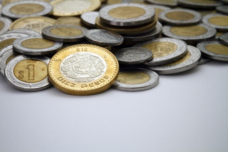 Ten Mexican Peso Coin Spot Lit Among Other Pesos dinero economia monedas divisas