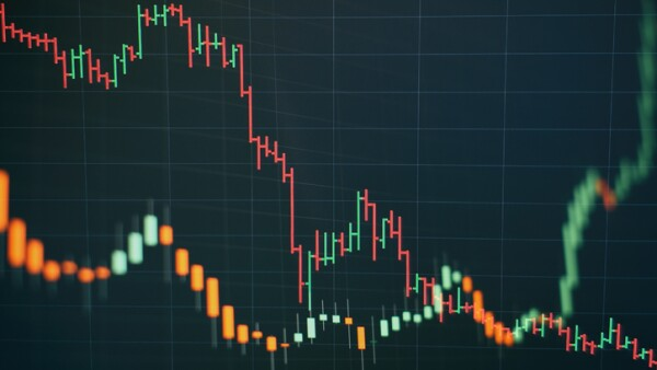 Technical price graph and indicator, red and green candlestick chart on blue theme screen, market volatility, up and down trend. Stock trading, crypto currency background.