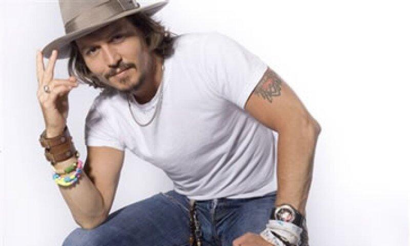 Johnny Depp ya estaba vinculado al mundo literario; era amigo del escritor y periodista Hunter Thompson.  (Foto: AP)