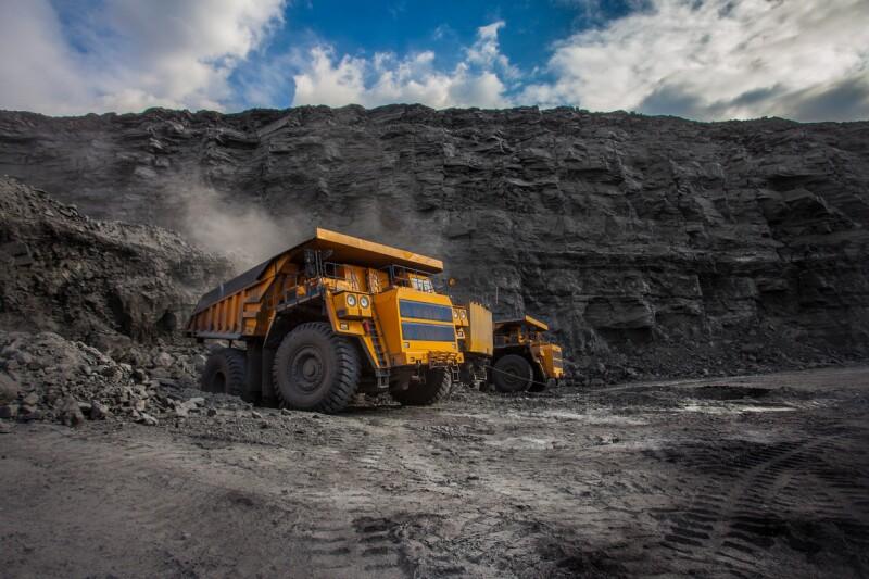 mining dump trucks loaded in a coal mine