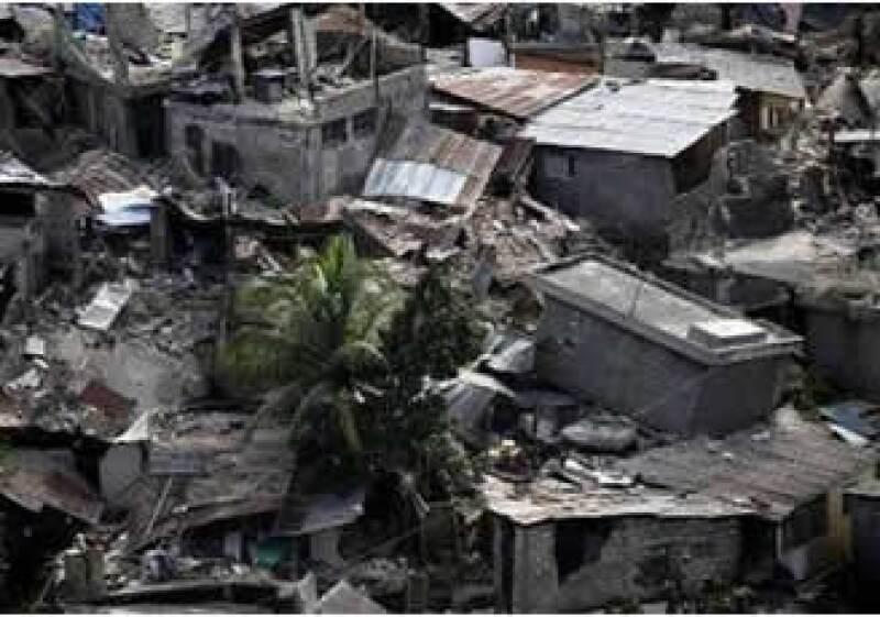 La tragedia en Haití dejó a muchos enterrados en escombros. (Foto: Reuters)