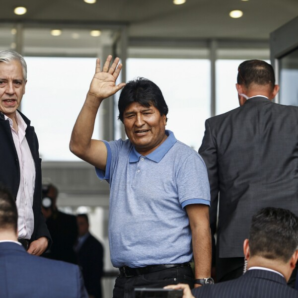 Bolivia's ousted President Evo Morales gestures during his arrival to take asylum in Mexico