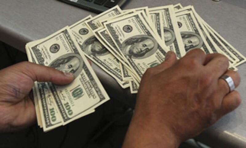 El tipo de cambio es de 13.1745 pesos para solventar obligaciones denominadas en moneda extranjera. (Foto: AP)
