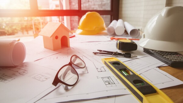 Concept architects, equipment architects On the desk with a blueprint in the office, Vintage, Sunset ligth.Selective Focus