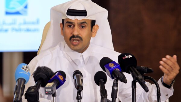 FILE PHOTO: Saad al-Kaabi, chief executive of Qatar Petroleum, gestures as he speaks to reporters in Doha