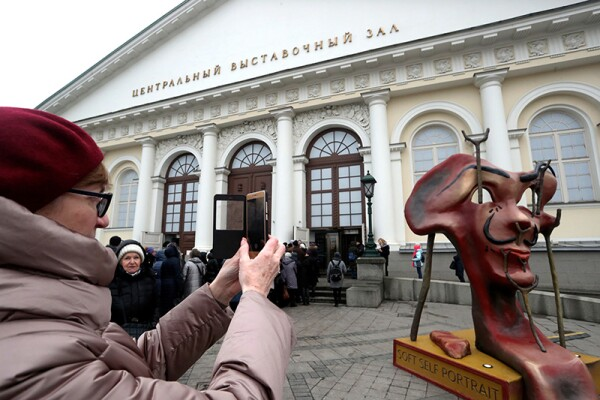 People queue outside Manege Central Exhibition Hall to attend Salvador Dali. Magic Art exhibition