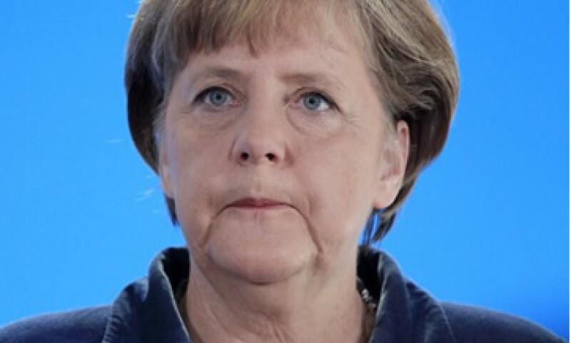 Angela Merkel abrirá la 42 edición del WEF, a la que asistirán jefes de Finlandia, Francia, Irlanda, Países Bajos y Reino Unido. (Foto: AP)