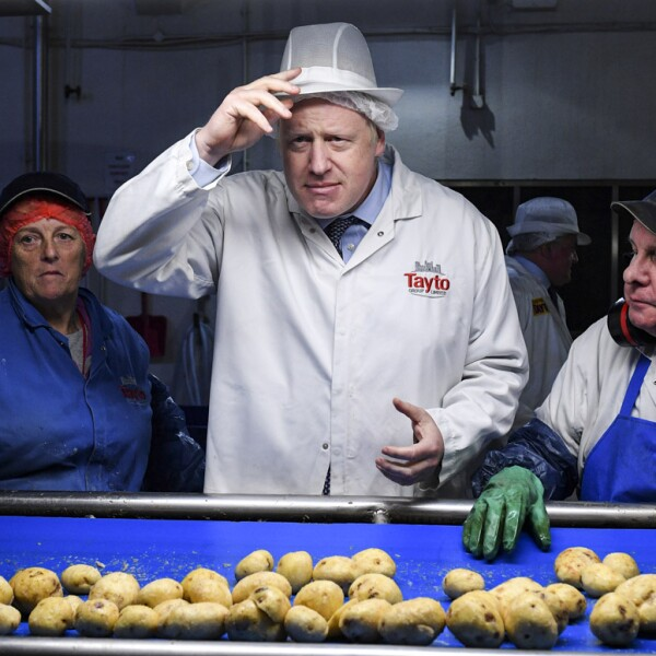 Britain's Prime Minister Boris Johnson visits the Tayto Castle crisp factory in County Armagh