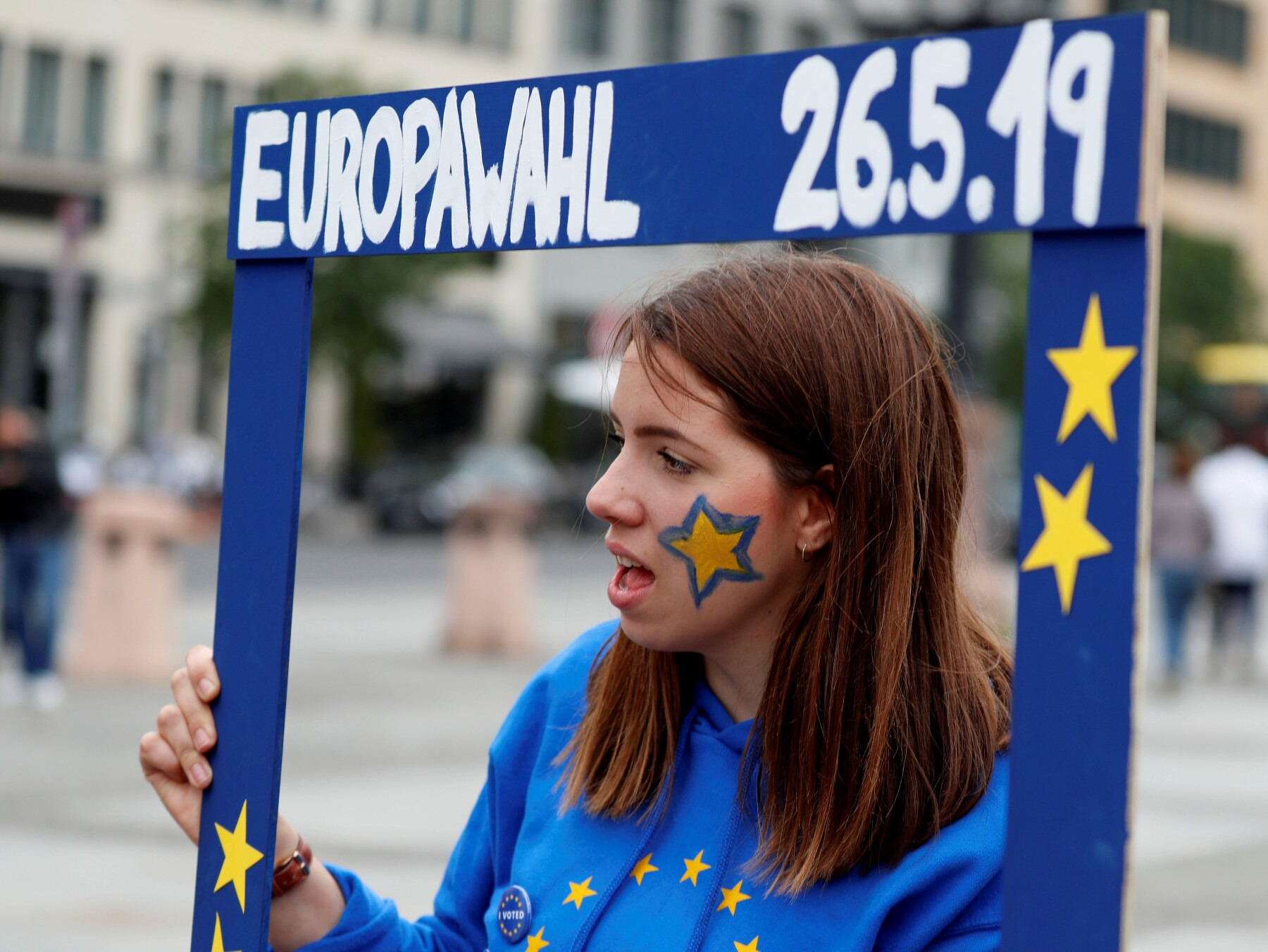 """FILE PHOTO: A woman attends an event by pro-European """"Pulse of Europe"""" movement, during the European Parliament elections at Gendarmenmarkt square in Berlin"""
