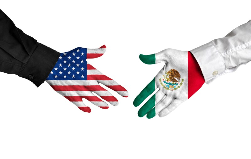 American and Mexican leaders shaking hands on a deal agreement