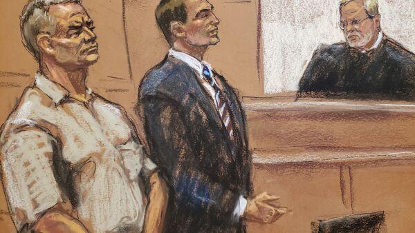 Genaro Garcia Luna stands beside his lawyer Cesar de Castro