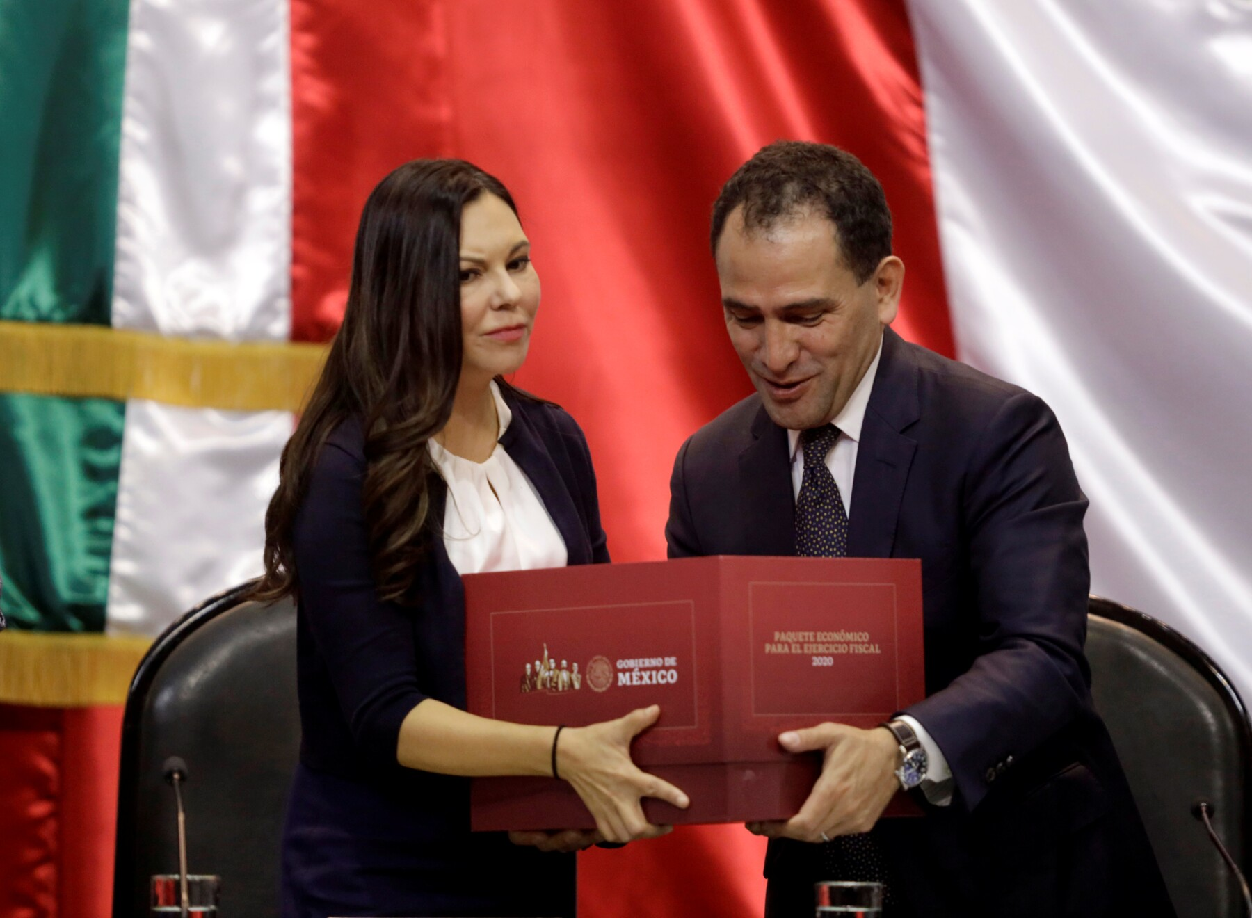 Mexico's Finance Minister Arturo Herrera presents the 2020 national budget to Laura Angelica Rojas president of the Lower House of Congress at the Congress building in Mexico City