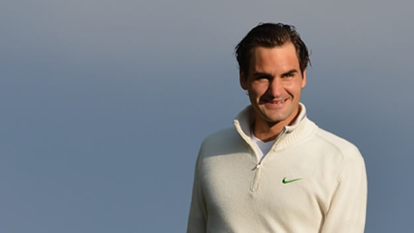 Roger Federer festeja su triunfo en Wimbledon