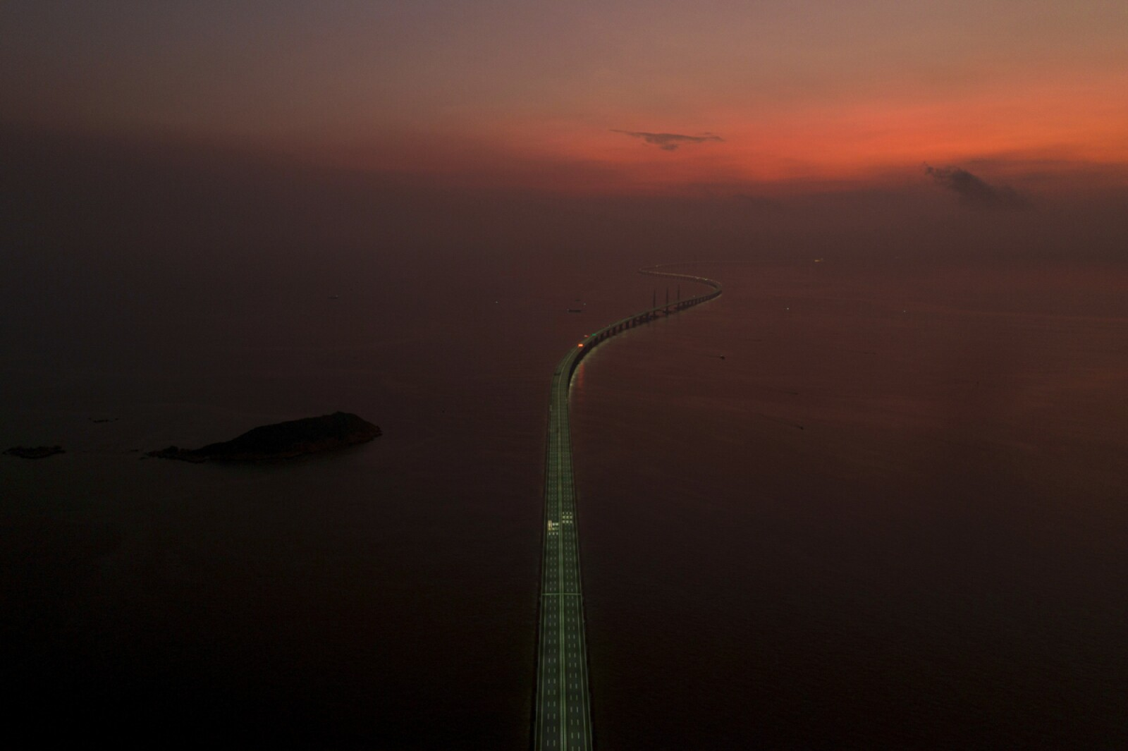 Aerial view shows the Hong Kong-Zhuhai-Macau bridge during sunrise off Zhuhai