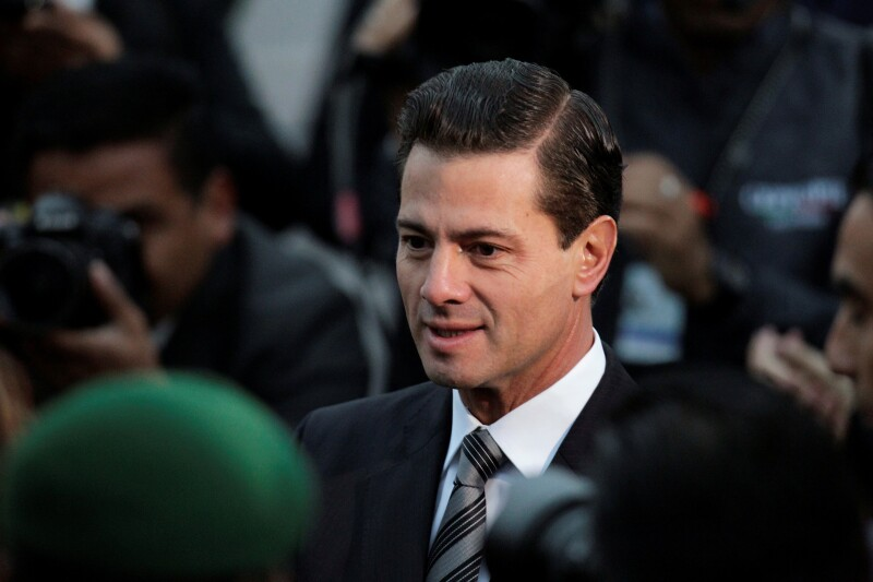 Mexican President Enrique Pena Nieto attends a flag-raising ceremony honouring the victims of the September 1985 and 2017 earthquakes at Zocalo square in Mexico City