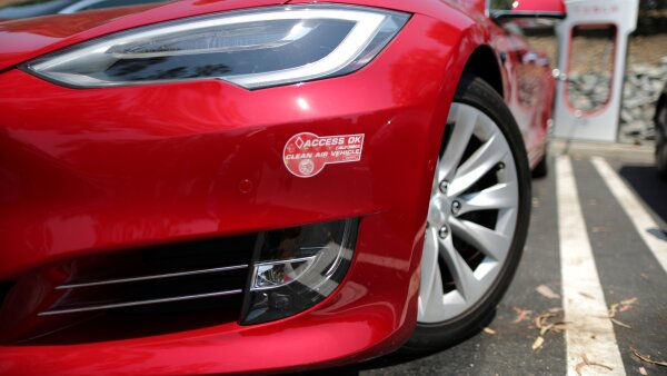 A clean air vehicle car pool lane sticker is seen on a Tesla at an electric car supercharger station in Los Angeles