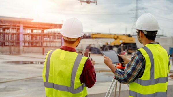 Drone operated by construction worker.