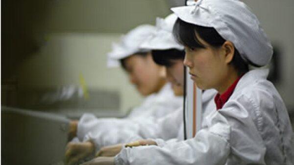 Si la economía china sigue en desaceleración, 2016 será un año mediocre para la economía mundial, dicen la OCDE y el FMI. (Foto: (EFE) )
