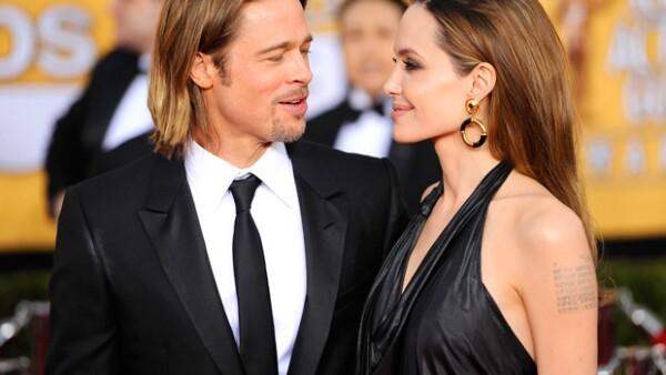 Brad y Angelina lucieron muy contentos al posar ante las lentes de cientos de camarógrafos.