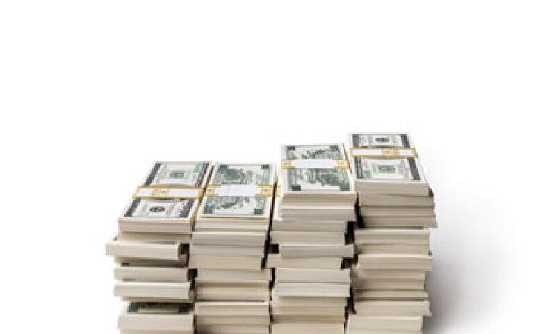 Las cifras positivas de EU impulsarían a la Fed a anunciar el primer paso para dejar el programa de bonos. (Foto: Getty Images)