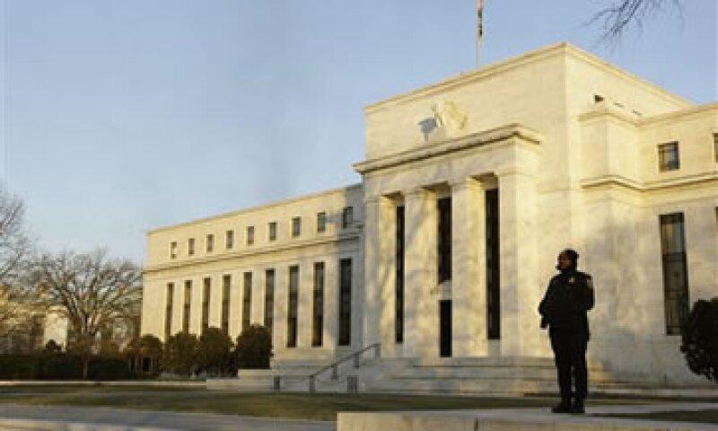 El informe de la Fed sugirió una tibia recuperación económica en EU. (Foto: AP)
