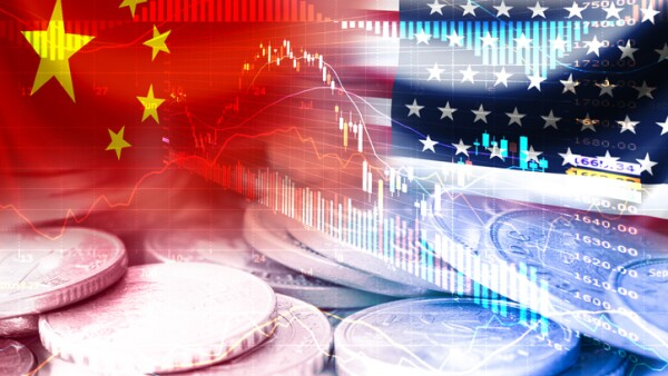 USA and China flag on coins and stock market chart .It is symbol of economic tariffs trade war and tax barrier between United States of America and China.